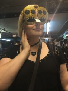 beautiful blonde blogger Mia Moore trying on some skull-shaped sunglasses