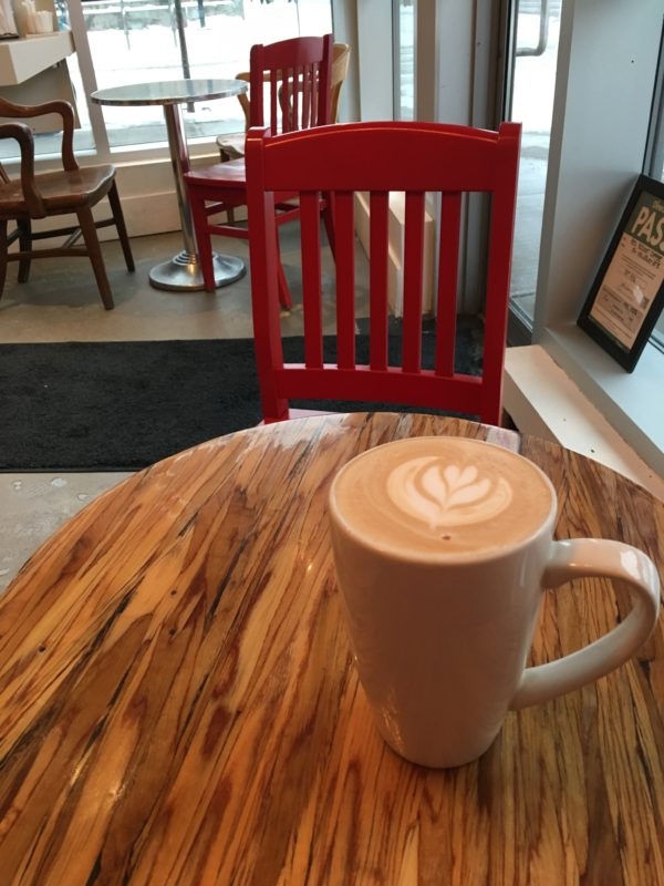 a chair, a table, and a latte