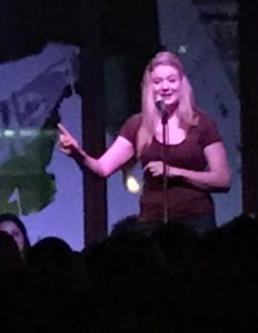 my beautiful blonde friend Georgia animatedly telling a story in front of a crowd