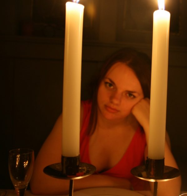 me gazing at you lovingly between two lit candles